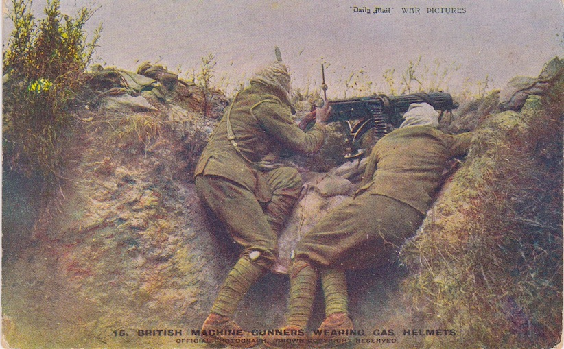 WW1 British Machine Gunners wearing gas helmets