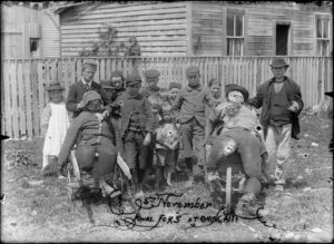 Children with rival guys, Guy Fawkes day at Ohingaiti. Child, Edward George, 1860-1949 :Photographs of the Ohingaiti district. Ref: 1/2-038752-G. Alexander Turnbull Library, Wellington, New Zealand