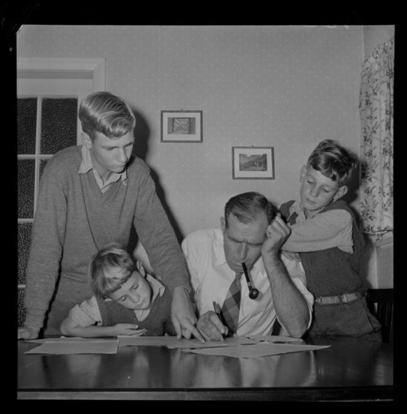 Mr M A Watts with his sons filling in census forms. Negatives of the Evening Post newspaper. Ref: EP/1956/0839-F. Alexander Turnbull Library, Wellington, New Zealand. http://natlib.govt.nz/records/22765006