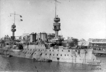 Port Said, Egypt. c 1915. The French Battleship Jaureguiberry at anchor. Her hull is painted a light grey, while the turrets are very dark grey or black. Note the extreme tumblehome of the hull. The dominant fighting tops and thick military masts common to French battleships completed in the 1890s. (Donated by Mr J.A. Henderson)Australian War Memorial ID: J06004