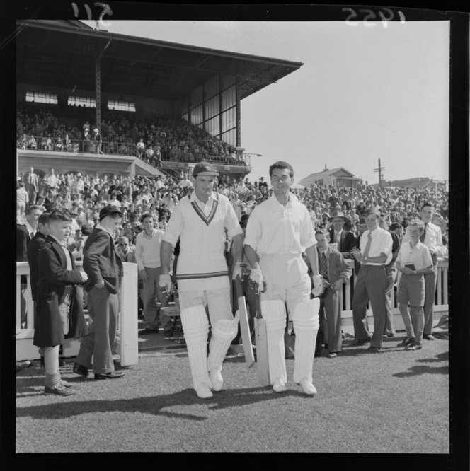 Marylebone Cricket Club opening batsmen T W Graveney and R T Simpson walking out on to the pitch at the Basin Reserve on the first day of the match against Wellington. Negatives of the Evening Post newspaper. Ref: EP/1955/0511-F. Alexander Turnbull Library, Wellington, New Zealand. http://natlib.govt.nz/records/23252525