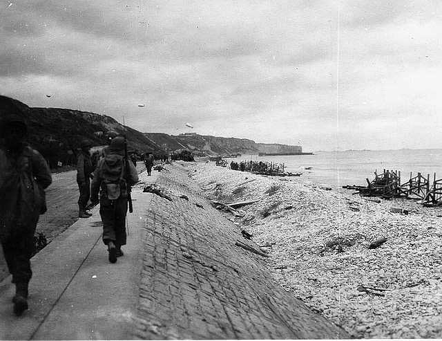 American soldiers walking along road towards western end of Omaha Beach Sourced from Battle of Normandy Tours http://www.battleofnormandytours.com/photos-omaha.html