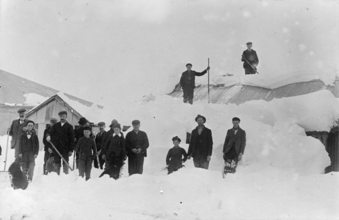 Group in snow at St Bathans, Central Otago - Photograph taken by F M Pyle. Paterson, M, fl 1966 : Photographs, particularly of St Bathans, Central Otago. Ref: 1/2-027135-F. Alexander Turnbull Library, Wellington, New Zealand. http://natlib.govt.nz/records/22349697