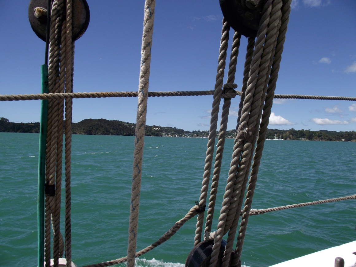 View of Kororareka/Russell through the rigging of the R. Tucker Thompson © Lemuel Lyes 2013