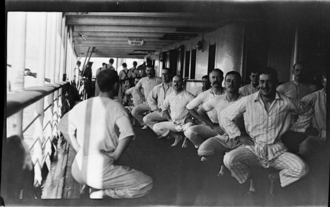 Officers exercising on a transport ship. Negatives taken by Rev Ernest Northcroft Merrington, all relating to World War 1, chiefly Gallipoli. Ref: 1/2-077943-F. Alexander Turnbull Library, Wellington, New Zealand. http://natlib.govt.nz/records/22634165