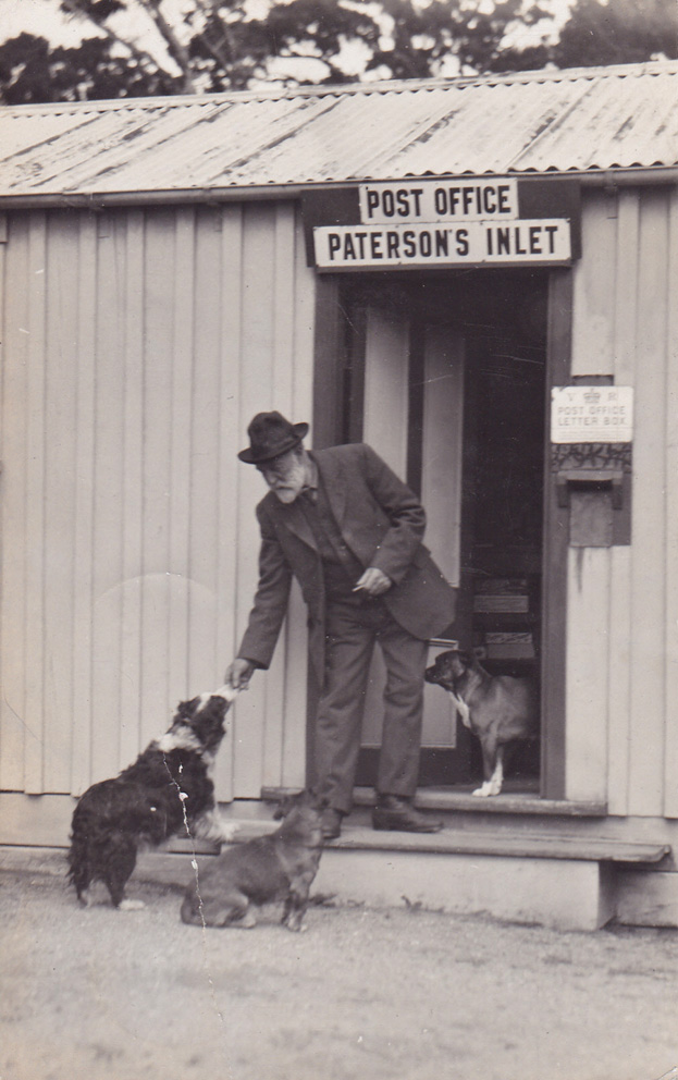 Gentleman with dogs at Paterson's Inlet Post Office. Photo courtesy of The Lothians