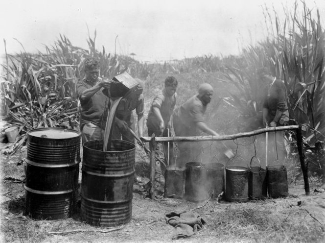 Men boiling down blackfish blubber, Tokerau Beach. Taaffe, James Thomas Benjamin, d 1971 :Photographs of the Far North district, Northland region. Ref: 1/2-026801-F. Alexander Turnbull Library, Wellington, New Zealand. http://natlib.govt.nz/records/23070974