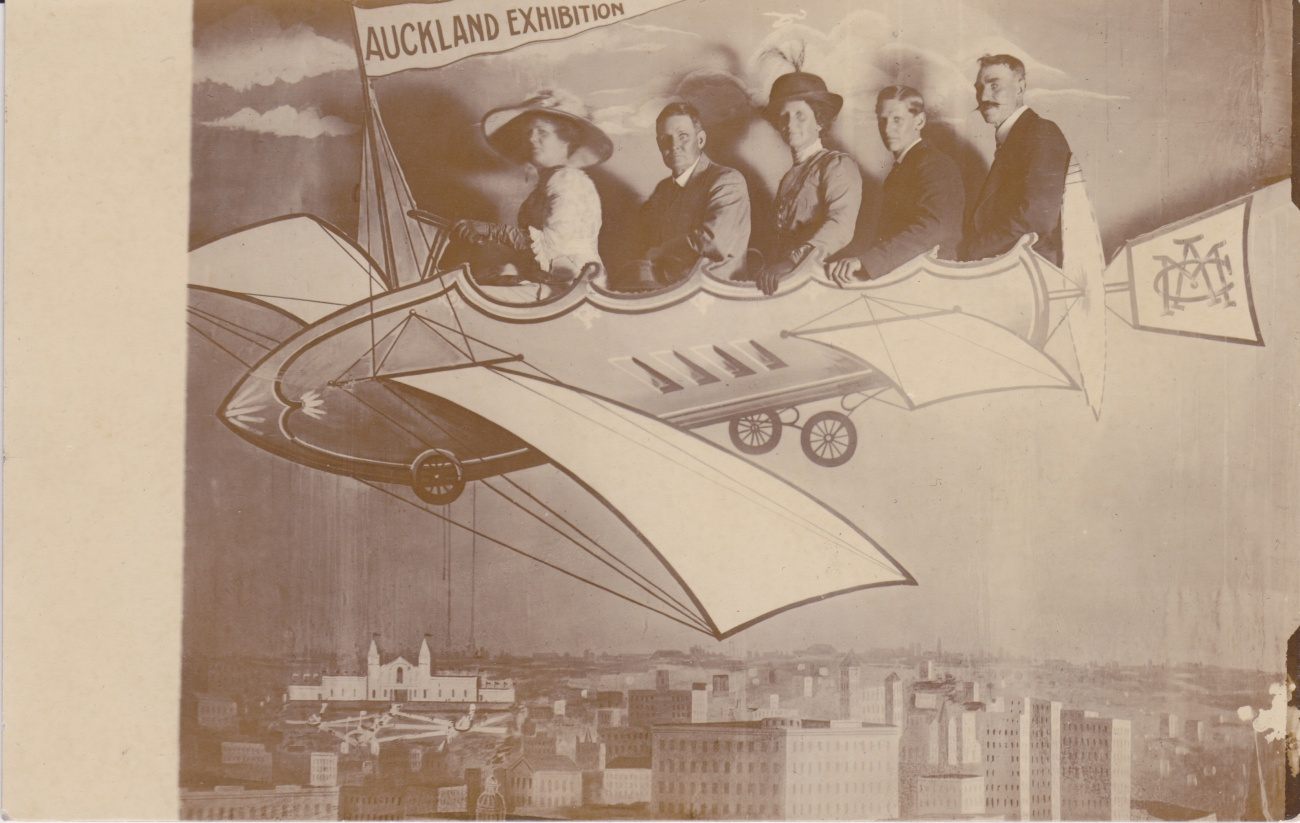 Auckland Exhibition attendees in a mock up flying machine Lemuel Lyes Collection