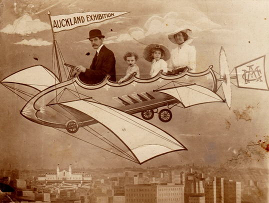 """Auckland Exhibition visitors enjoy a ride in a mock up """"flying machine"""" Courtesy of Timespanner"""