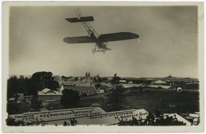 Beattie, William, 1864-1931. Bleirot monoplane Britannia flying over Auckland Exhibition Grounds. Thompson, D (Mrs) fl 1975 :Postcards of New Zealand scenes. Ref: PAColl-0892-12. Alexander Turnbull Library, Wellington, New Zealand. http://natlib.govt.nz/records/22305336