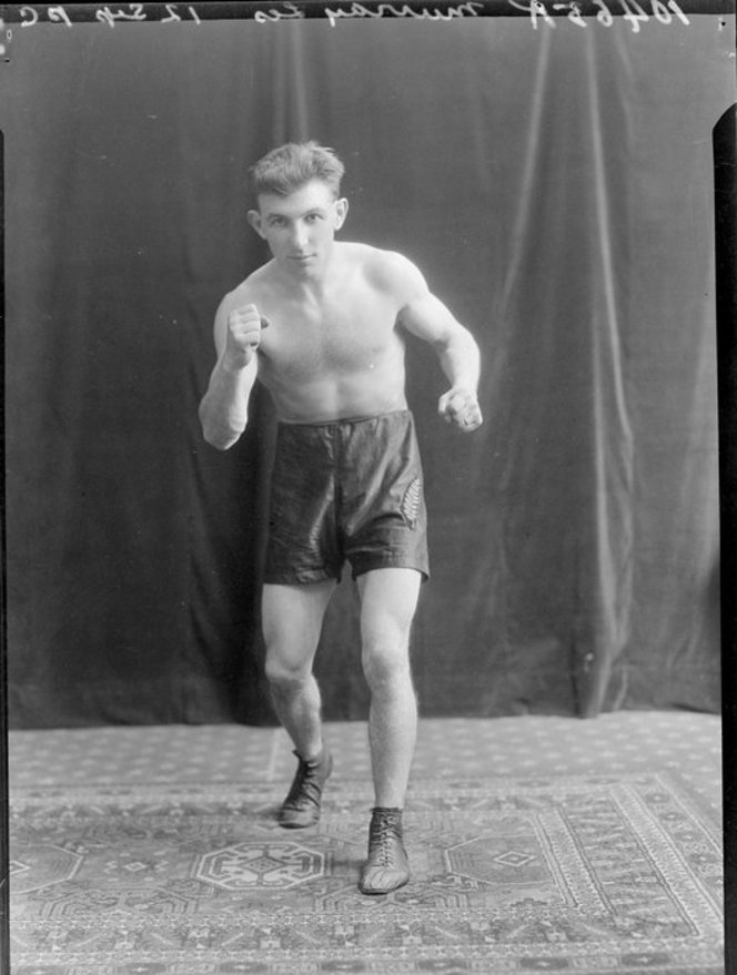 Mr Les Murray, boxer. Crown Studios Ltd :Negatives and prints. Ref: 1/2-204959-F. Alexander Turnbull Library, Wellington, New Zealand. http://natlib.govt.nz/records/22861462