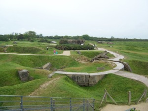 Bomb craters and the remains of fortifications at Pointe du Hoc, Normandy