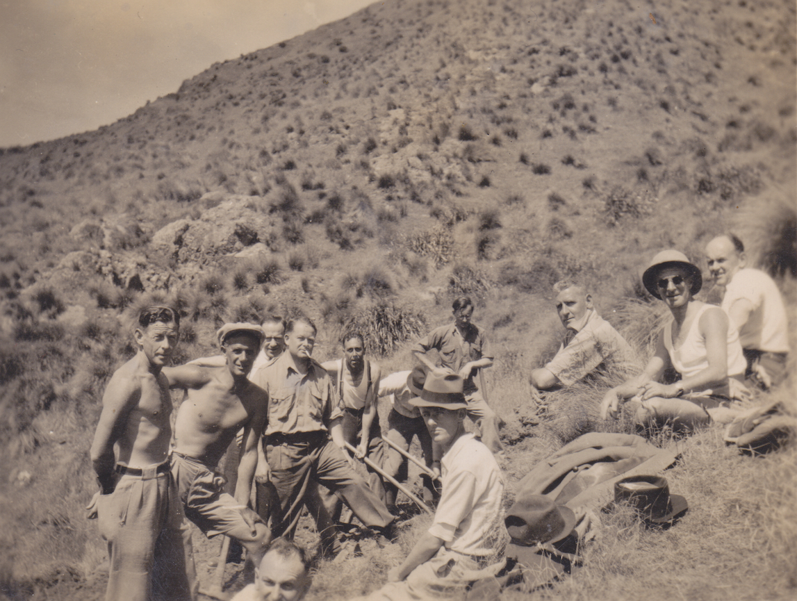 Members of No. 11 Platoon, Makara Battalion, New Zealand Home Guard, digging defensive positions at Ohariu Bay, Makara, 1942. From L to R they are Button, Pine, Welsh, Rhodes, Hall, Leighton, Stewart,Yates and Fowler.
