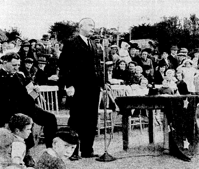 Prime Minister Peter Fraser addressing the Makara Battalion of the Home Guard and Women's War Service Auxiliary and Red Cross units at Karori Park, 30 November 1941. Evening Post, Volume CXXXII, Issue 132, 1 December 1941, courtesy of Papers Past